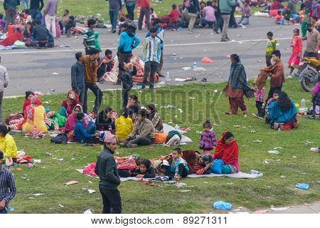 KATHMANDU, NEPAL - APRIL 26, 2015: People stay on an open ground at Tundikhel after their first night outside after the 7.8 earthquake on 25 April 2015.