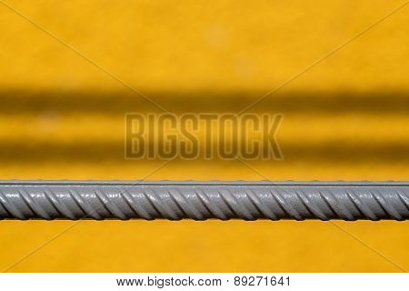 Gray Rod Of Fittings On A Yellow Background
