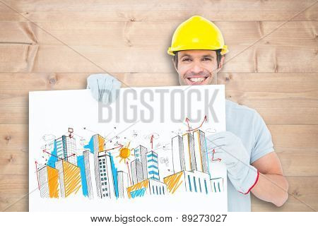 Happy architect with bill board over white background against bleached wooden planks background