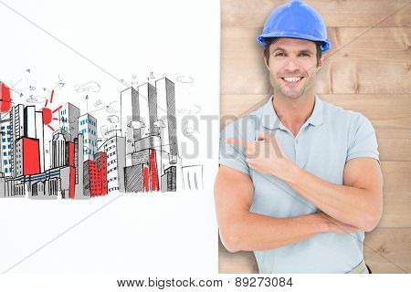 Smiling architect with bill board over white background against bleached wooden planks background