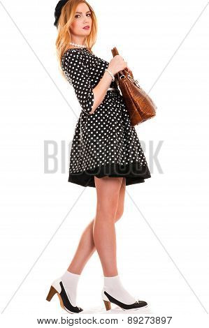 fashionable woman with a bag in hands