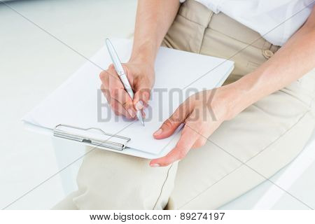 Therapist taking notes on white background