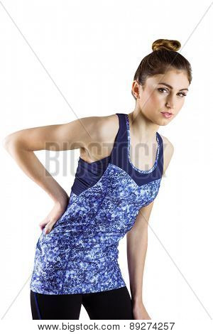 Fit brunette with back injury on white background