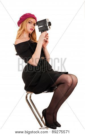 woman director sitting with a video camera in hands