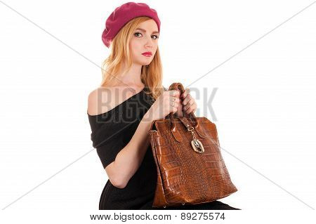sexy fashionable woman sitting with a bag in hands