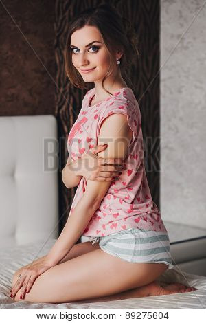 beautiful girl with long hair in pajamas