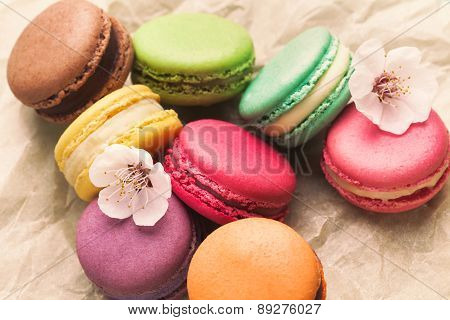 Macarons lying on piece of parchment