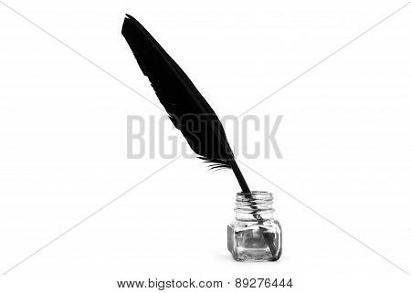 Black feather and empty ink pot