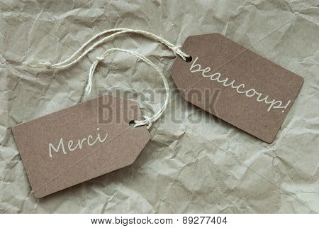 Two Labels Merci Beau Means Thank Paper Background