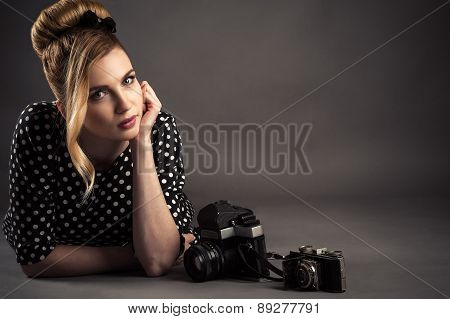 beautiful woman lying on the floor with two camera