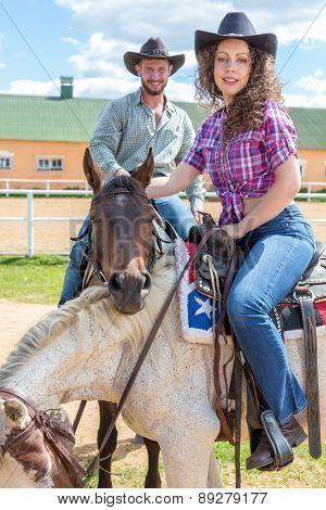 cowboy couple on embracing horses