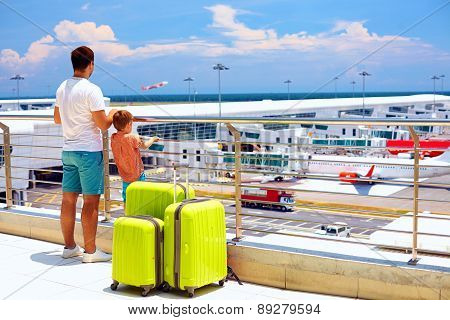 Family Waiting For Boarding In International Airport, Summer Vacation