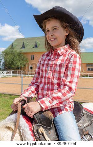 cowboy girl on horseback smiling closeup