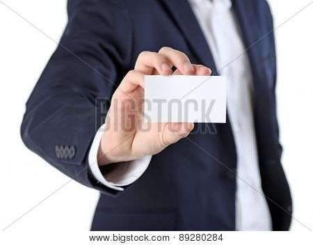Elegant man in suit holding business card, isolated on white