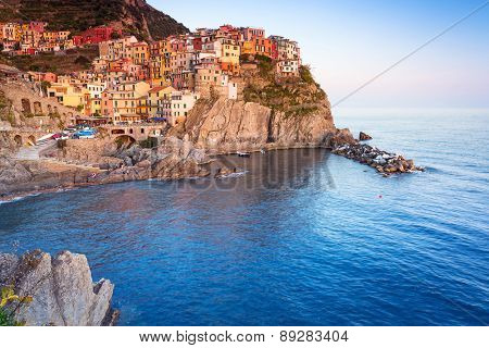 Manarola town on the coast of Ligurian Sea at sunset, Italy
