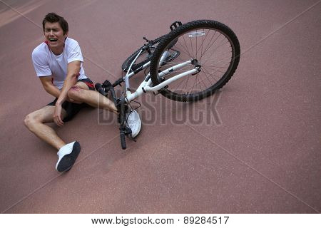 Young man injured during riding a bike