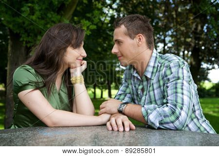 Young couple holding hands and looking at each other
