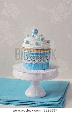 Blue cupcake on a stand