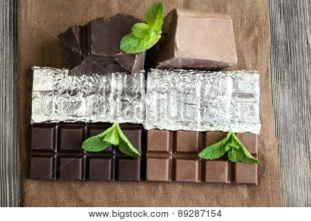 Set of spicy chocolate on wooden table, closeup