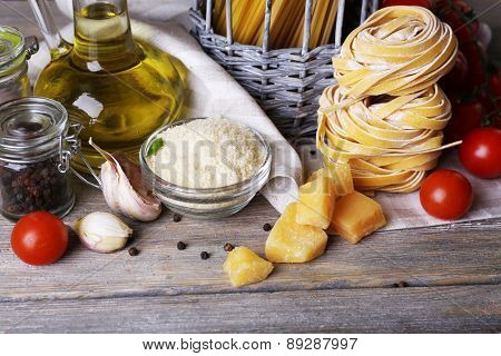 Pasta with cherry tomatoes and other ingredients on wooden table, closeup
