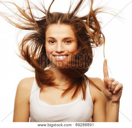 Pretty girl with great fly-away hair. Over white background