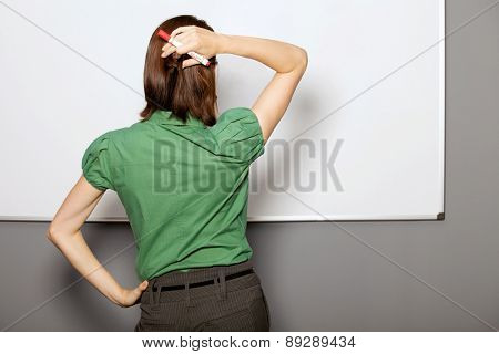 Businesswoman standing in front of whiteboard in office