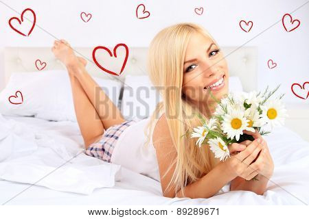 Beautiful young woman dreaming about love