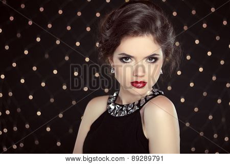 Beautiful Brunette Woman Model With Makeup And Hairstyle In Fashion Necklace Over Bokeh Lights Backg