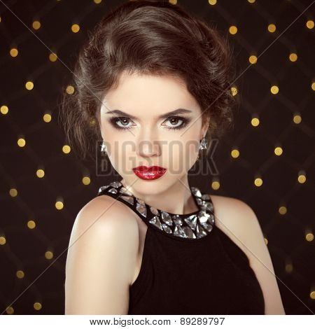 Beautiful Elegant Girl Model With Jewelry Necklace, Makeup And Hair Styling. Isolated On Lights Blac