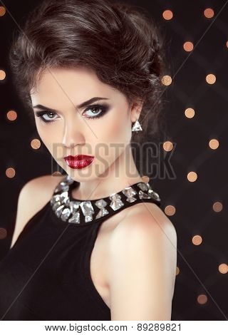 Fashion Glamour Elegant Lady Portrait With Red Lips And Hairstyle Over Lights Background. Attractive
