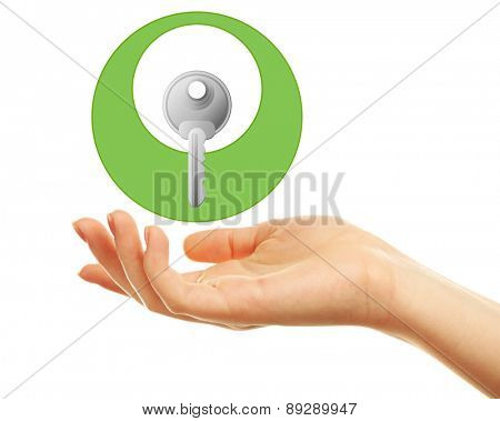 Female hand with key isolated on white