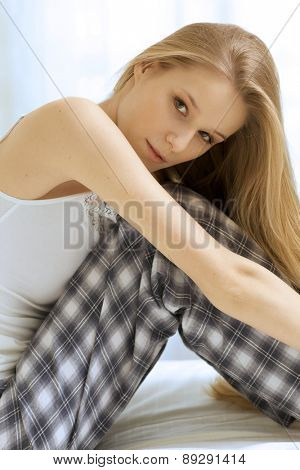 Woman sitting in bed