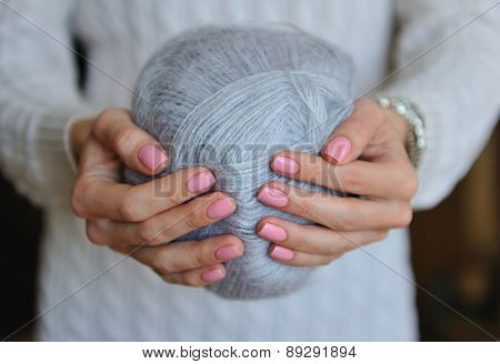 Skein of thread in female hands