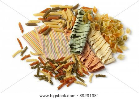 Variety of colorful traditional Italian pasta on white background