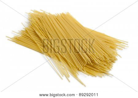 Heap of raw dried traditional Italian spaghetti on white background