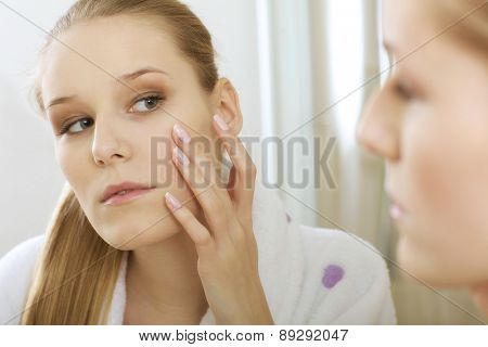 Woman reflaction in mirror