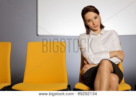 Portrait of businesswoman sitting in waiting room