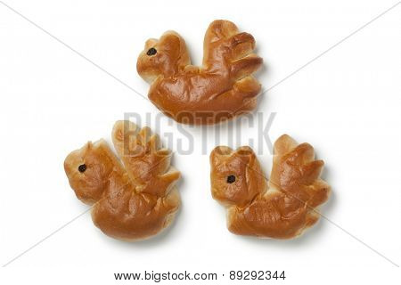 Three traditional palm sunday rolls in the shape of a rooster on white background