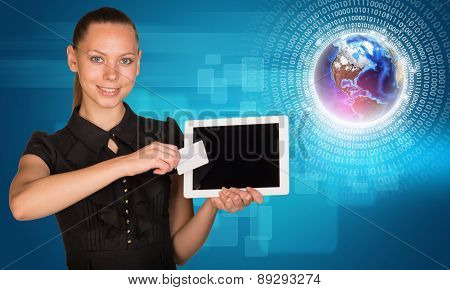 Businesswoman with 3d Earth model