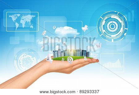 Cityscape in hand on sky background
