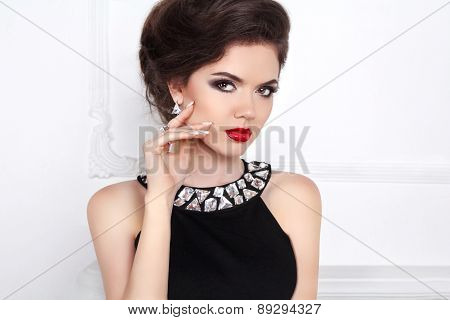 Glamour Portrait Of Beautiful Woman Model With Red Lips And Hair Styling In Luxury Fashion Jewels.