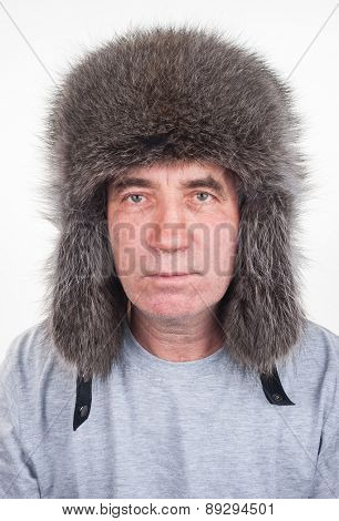 A man in a hat of raccoon