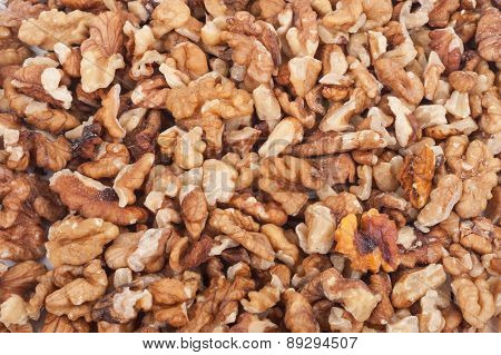 Heap of unshelled walnuts