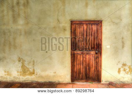 Old Wooden Door In A Grunge Wall