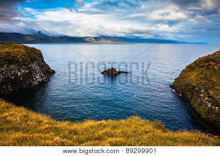 The picturesque coastal bay near the fishing village of Arnastapi. Iceland in summer