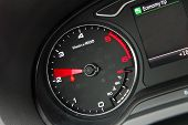 foto of mph  - Car Tachometer photographed in a car that stands - JPG