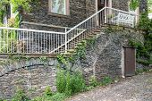 foto of stone house  - Old house with brick stone facade and stone stairs - JPG