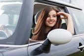 stock photo of driving school  - Young beuatiful woman driving a car - JPG