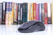 pic of online education  - Computer mouse with focus with books in background - JPG