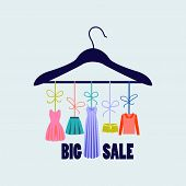 picture of clothes hanger  - hanger with fashion women summer clothing - JPG